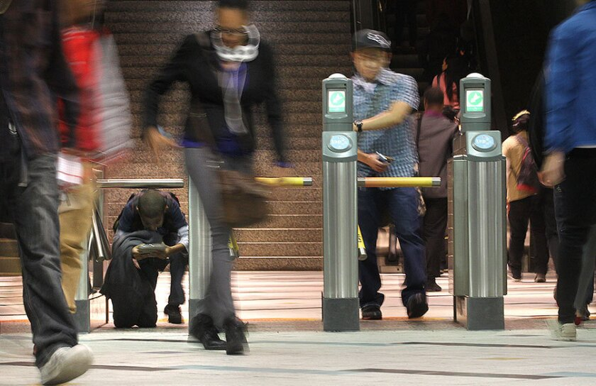 A Times analysis found a large gap between Metro's estimated rail ridership (115 million last year) and the number of fares counted (about 70 million).
