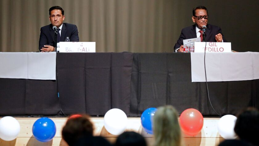 Joe Bray-Ali, left, and Councilman Gil Cedillo at a candidates forum for Council District 1 last month.