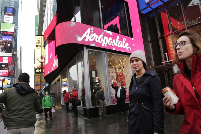 Women pass an Aeropostale store in New York's Times Square on Dec. 2.