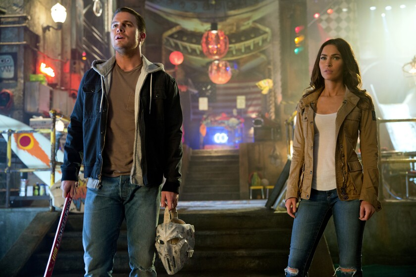 """Stephen Amell and Megan Fox star in """"Teenage Mutant Ninja Turtles: Out of the Shadows"""" from Paramount Pictures, Nickelodeon Movies and Platinum Dunes."""