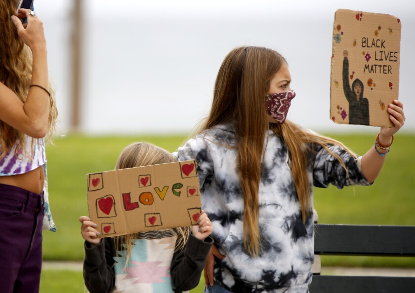 Dozens of Black Lives Matter protesters like these children held signs and chanted at Main Beach Park.