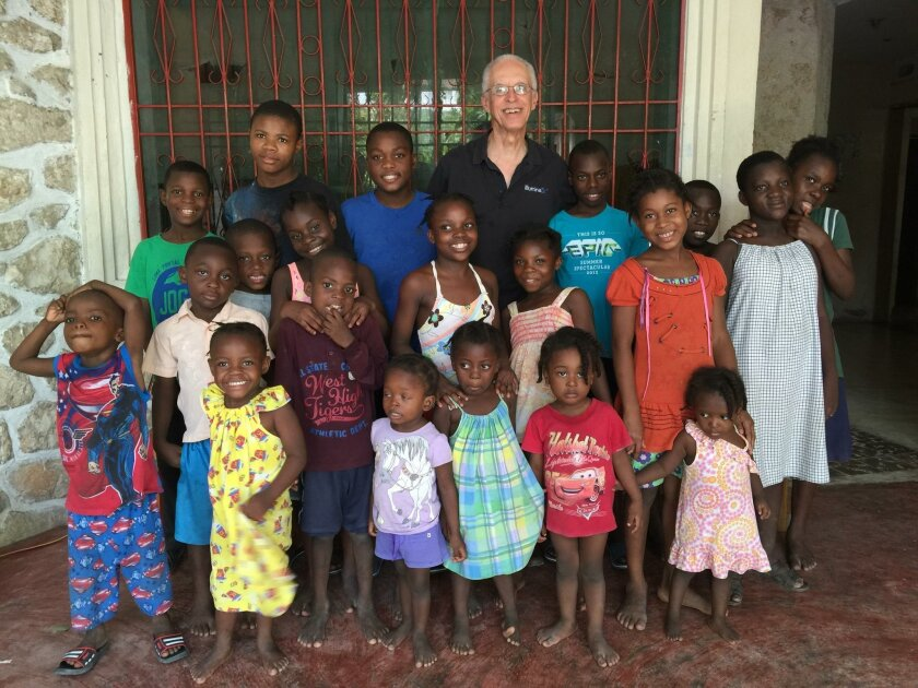 Fredrick Clerie (at center, with glasses) — who is partnered with La Jolla Rotary in an upcoming humanitarian project in Haiti — with a group of kids during his recent trip to the Hopestart Children's Home in Jeremie, Haiti