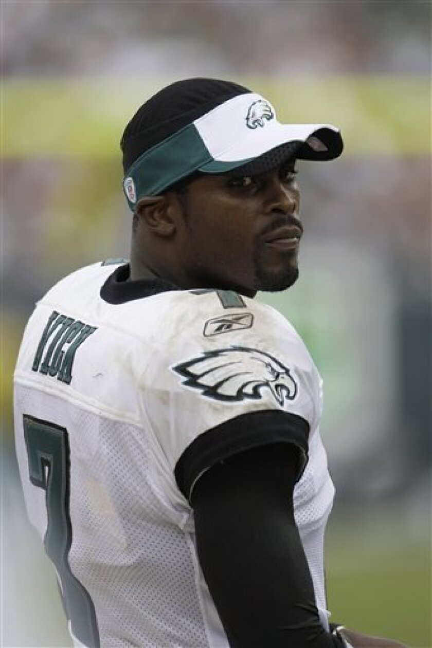 In this Sept. 27, 2009, file photo, Philadelphia Eagles quarterback Michael Vick is seen during an NFL football game against the Kansas City Chiefs, in Philadelphia. Despite his ascendancy to starting quarterback and several winning performances in that role, Vick has not won over many of the animal-loving Eagles fans who were the most incensed when he was signed last year. (AP Photo/Matt Slocum, File)