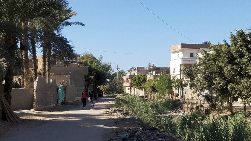 Boys walk to school in Rashid, where some families and friends encourage youths to migrate to Italy. Those who survive the dangerous journey send money home to build houses.