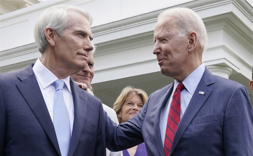 Rob Portman and other lawmakers stand outside the White House with Joe Biden.
