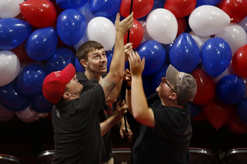 Workers at the Quicken Loans Arena load 125,000 balloons to be dropped during the Republican National Convention.