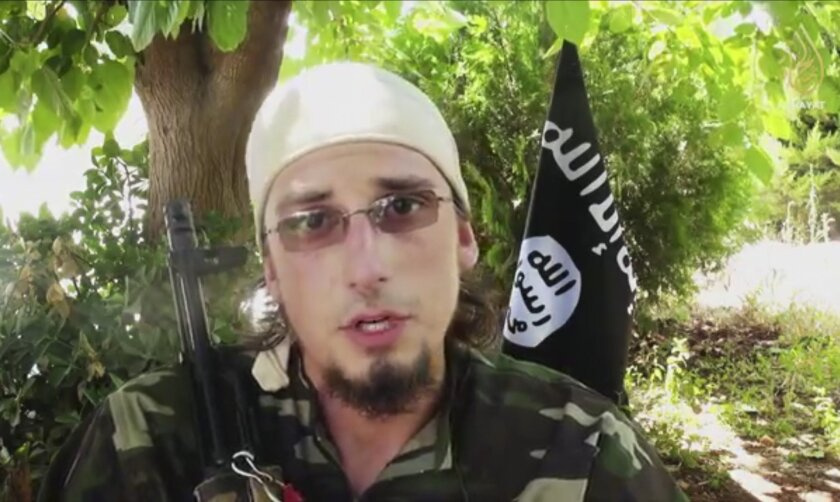 This undated image made from a video released by Islamic State militants appears to show Andre Poulin, a Canadian enlistee in the Islamic State group, speaking in a video that has been used for online recruitment. He was reported killed in August 2014 during an assault on a government-controlled airfield. (Militant video via AP)