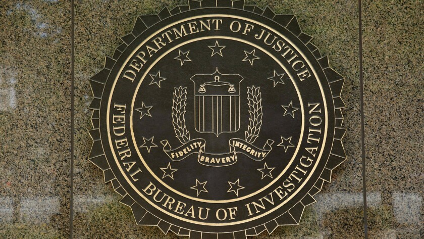 The FBI logo is seen outside the headquarters building in Washington, DC on July 5, 2016.