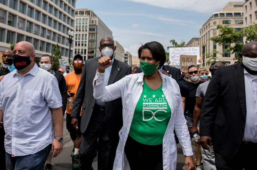 Washington, D.C., Mayor Muriel Bowser marches with demonstrators in her city.
