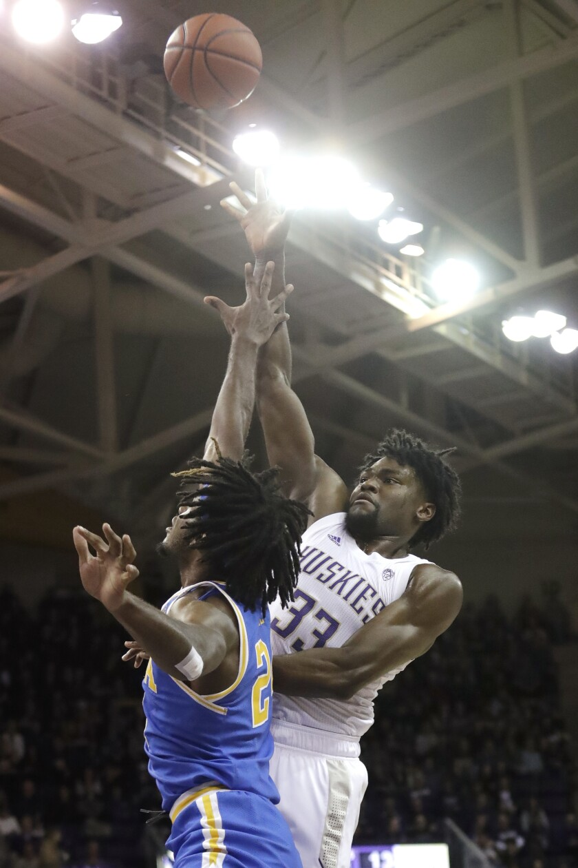 Washington's Isaiah Stewart (33) shoots over UCLA's Jalen Hill in the first half of an NCAA college basketball game Thursday, Jan. 2, 2020, in Seattle. (AP Photo/Elaine Thompson)