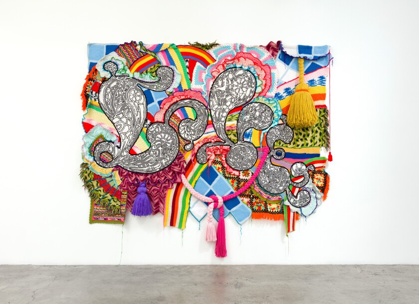 """""""Love"""" by Miyoshi Barosh, 2007. Found afghans, knitted fabric, yarn, pom-poms on canvas, 100 inches by 114 inches by 10 inches"""
