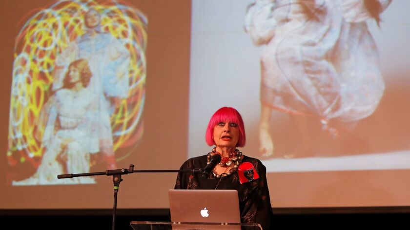 British fashion designer Zandra Rhodes shares her experiences with fashion and costume design during a talk at Huntington Beach High School on Tuesday. Rhodes has designed clothes for celebrities such as Princess Diana, Freddie Mercury and Joan Rivers.