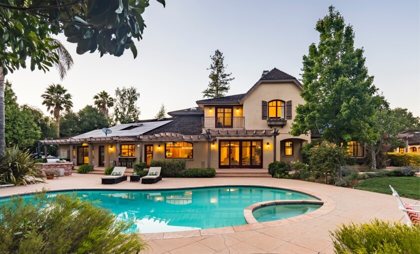 The 1.3 acre estate includes a main house and guest house which combine for over 8,500 square feet.
