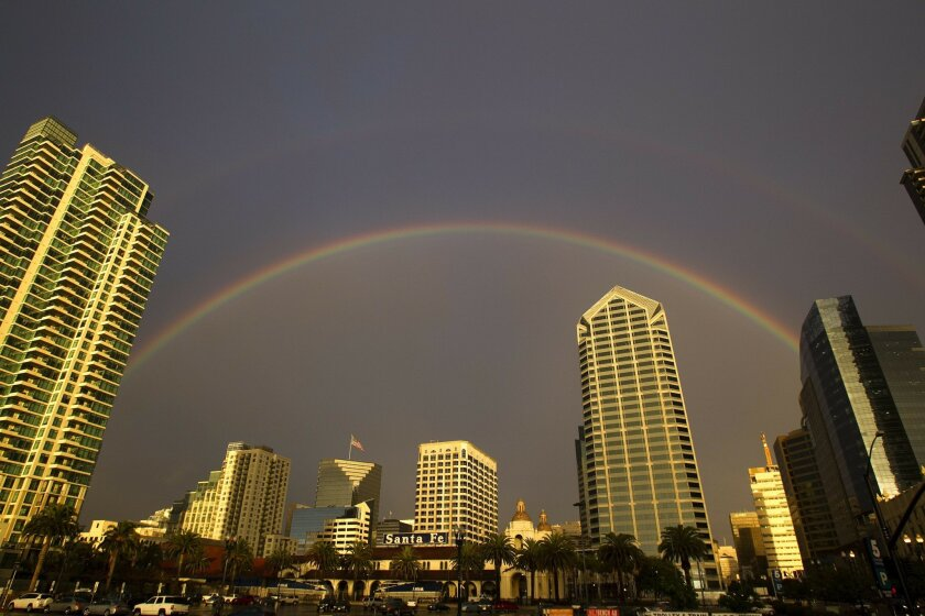 A double rainbow graces the San Diego skyline over the Santa Fe train station along Pacific Highway near Broadway.