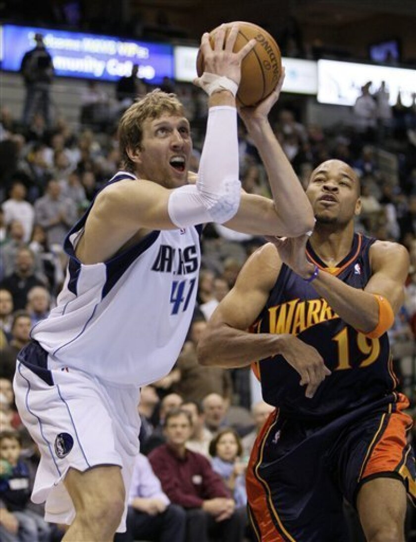 Dallas Mavericks forward Dirk Nowitzki (41), of Germany, gets by Golden State Warriors forward Devean George (19) as he leans forward to make a shot in the second half of an NBA basketball game, Wednesday, Feb. 3, 2010, in Dallas. The Mavericks won 110-101. (AP Photo/Tony Gutierrez)
