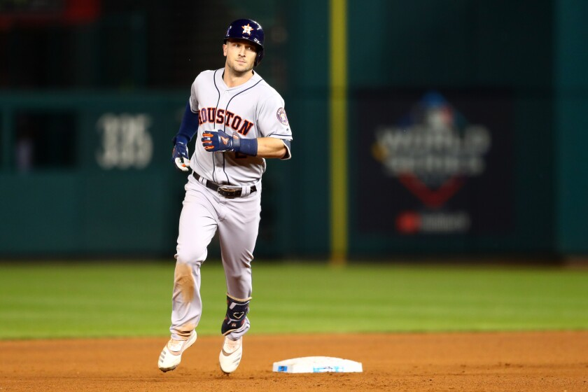 The Astros' Alex Bregman rounds the bases after hitting a seventh-inning grand slam Saturday night.