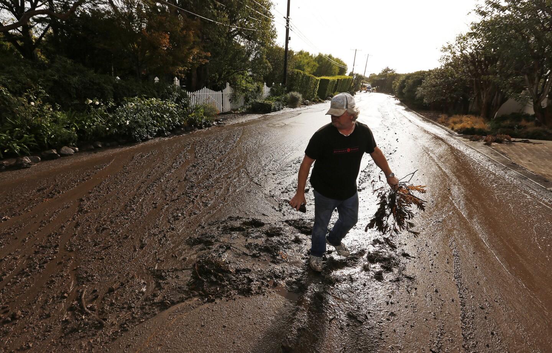 Storm rolls across fire-scarred regions of California