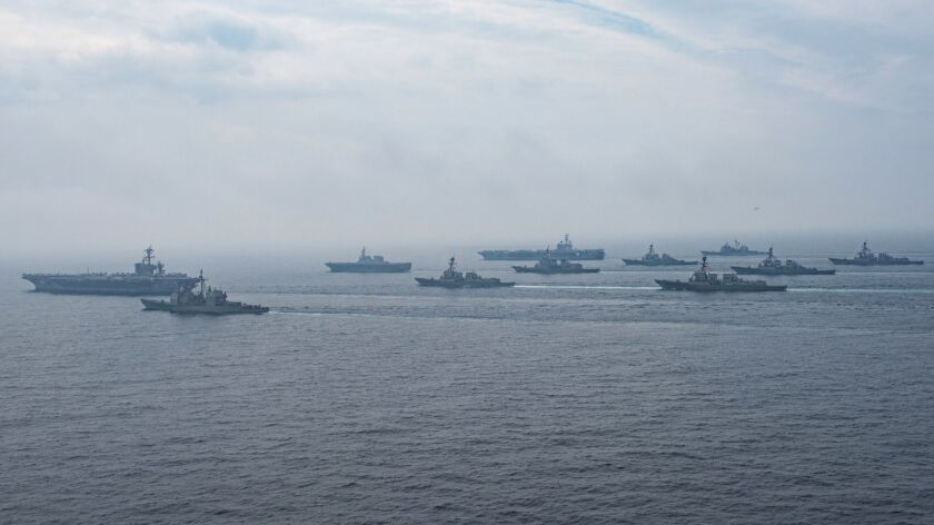June 1, Sea of Japan: The aircraft carrier Carl Vinson, cruiser Lake Champlain and destroyers Wayne