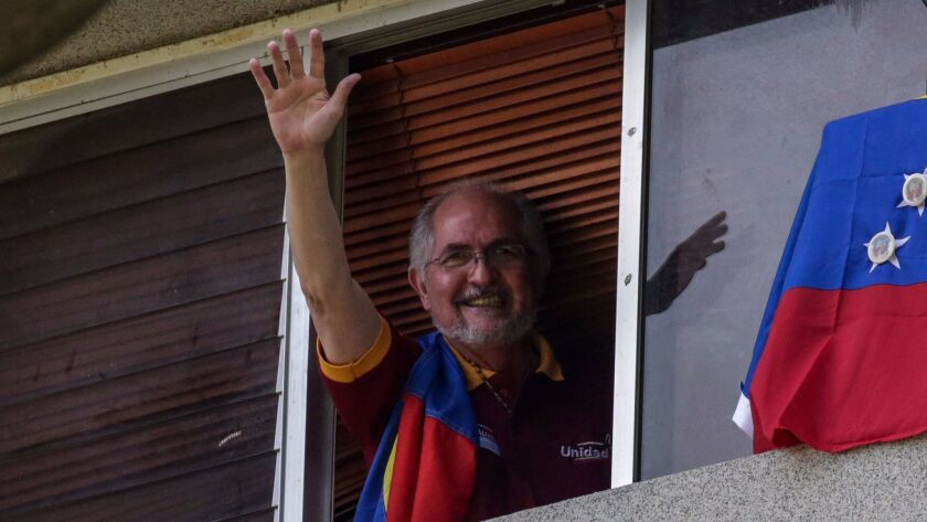 Antonio Ledezma, former mayor of Caracas, waves from his home July 16. He was seized from there on T
