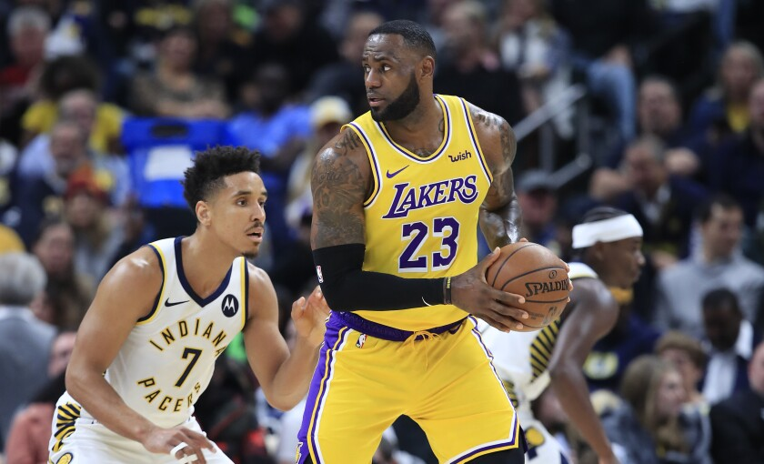 Lakers forward LeBron James is defended by Pacers guard Malcolm Brogdon during a game Dec. 17, 2019, at Indianapolis.