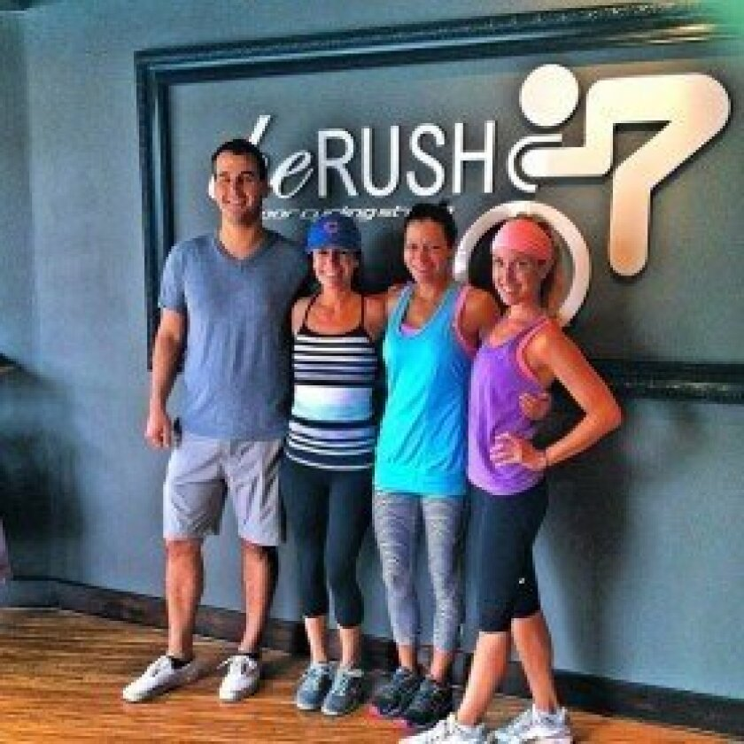 The Rush Indoor Cycling Studio's co-founder Corey Spangler, on left, with a group of riders. Courtesy photo