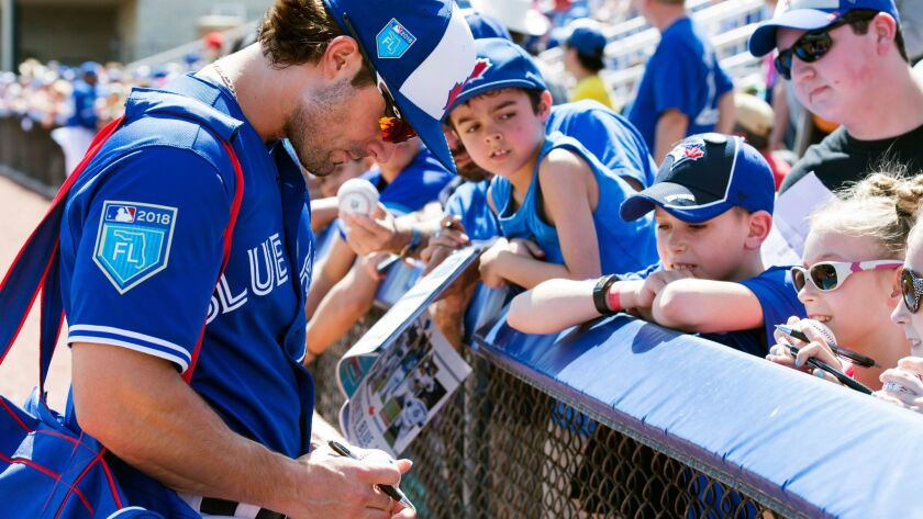 Toronto Blue Jays fielder Randal Grichuk signs autographs for fans prior to exhibition baseball acti