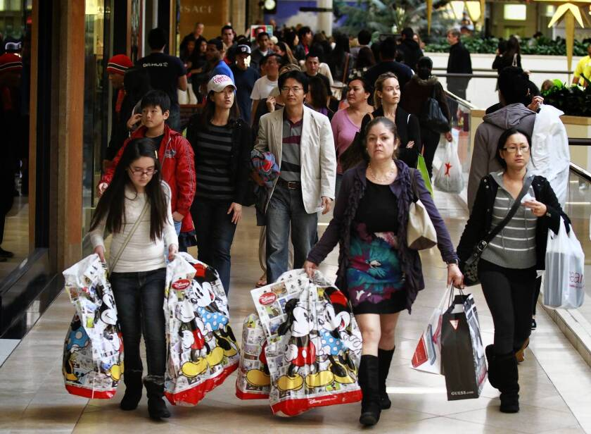 Shoppers flock to South Coast Plaza in Costa Mesa for Black Friday specials last year.