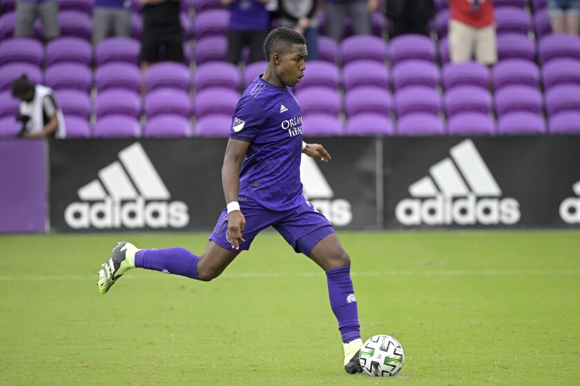 FILE - In this Nov. 21, 2020, file photo, Orlando City midfielder Andrés Perea makes a penalty kick during overtime of an MLS soccer playoff match against New York City FC in Orlando, Fla. Perea is among several dual nationals at American training camp this week ahead of a Dec. 9 exhibition against El Salvador in Fort Lauderdale, Fla. U.S. coach Gregg Berhalter will try to persuade them to commit to the U.S. program. (AP Photo/Phelan M. Ebenhack, File)