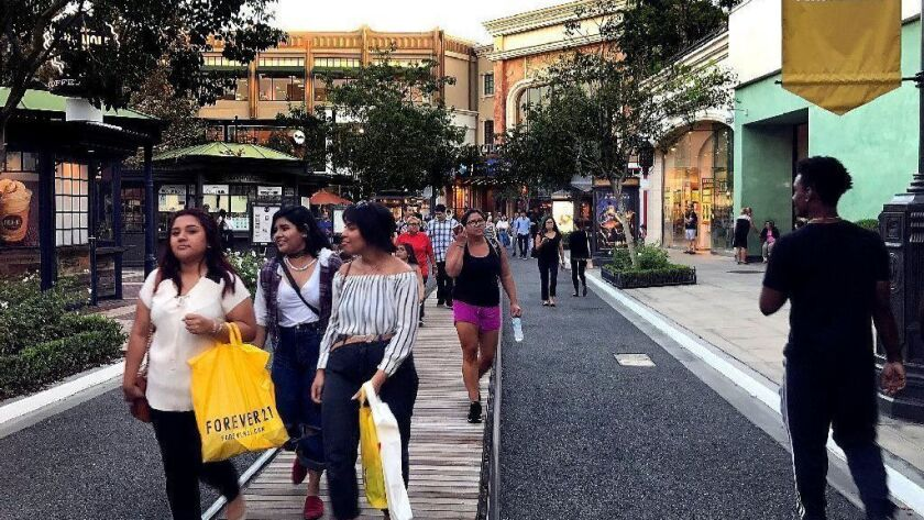 Shoppers make their way on the grounds of the Americana at Brand shopping center in Glendale. (Mel Melcon/Los Angeles Times)