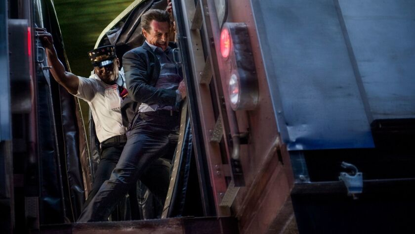 """Conductor Sam (Colin McFarlane), left, and Michael (Liam Neeson) in """"The Commuter."""""""