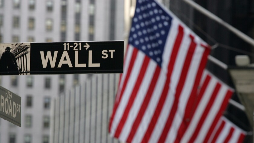 A Wall Street sign in New York. The market's latest pullback cuts further into what had been a solid rebound this month.