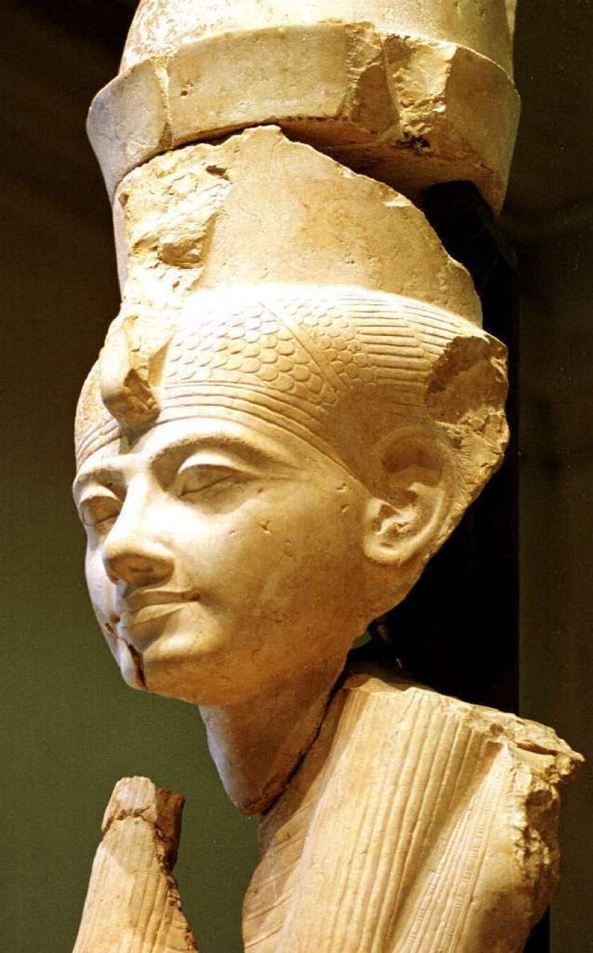 The goddess Mut's temple complex led archaeologist Betsy Bryan to unearth a ritual of binge drinking and orgiastic sex called the Festival of Drunkenness. Here, a statue of Mut's head is unveiled at the Egyptian Museum in 1999.