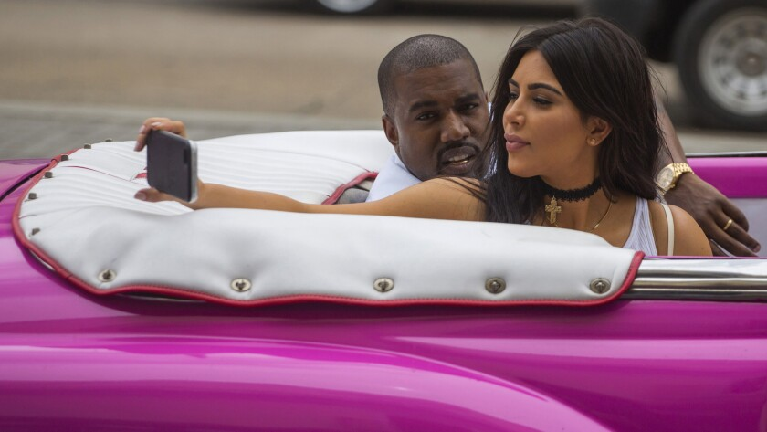 Kim Kardashian takes a selfie while riding with Kanye West in a classic car in Havana, Cuba, on May 5.