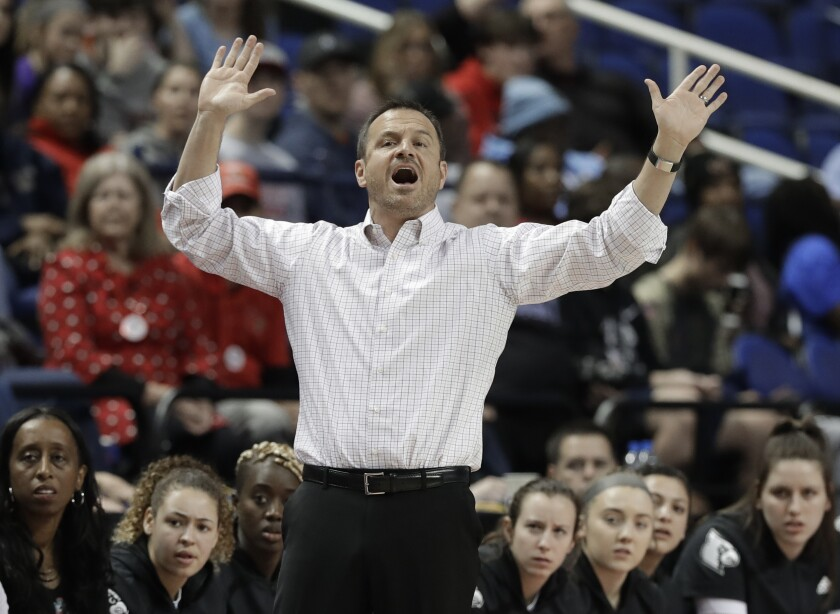 FILE - In this Friday, March 8, 2019, file photo, Louisville head coach Jeff Walz directs his team against Clemson during the first half of an NCAA college basketball game in the Atlantic Coast Conference women's tournament in Greensboro, N.C. Knowing that cancellations and postponements of games would be the norm this season amid the coronavirus pandemic, Walz started a text chain with a dozen coaches so that they could schedule games at the last minute when cancellations happened. (AP Photo/Chuck Burton, File)