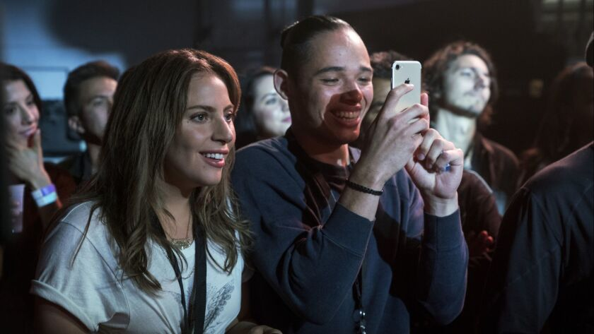"""(L-R) LADY GAGA as Ally and ANTHONY RAMOS as Ramon in a scene from """"A Star is Born."""" Credit: Clay En"""