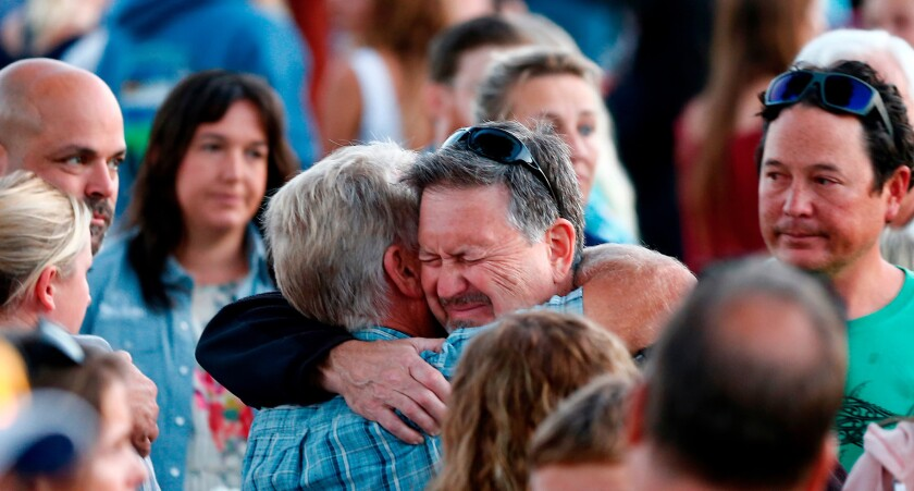 At vigil for Conception boat fire victims, love of diving unites and soothes mourners