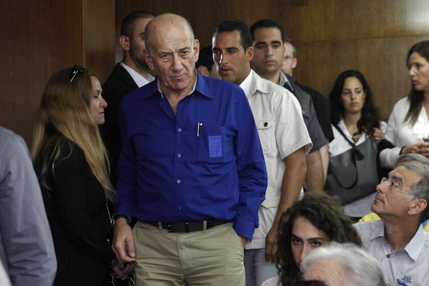 Ehud Olmert stands at the Tel Aviv District Court on May 13, 2014.