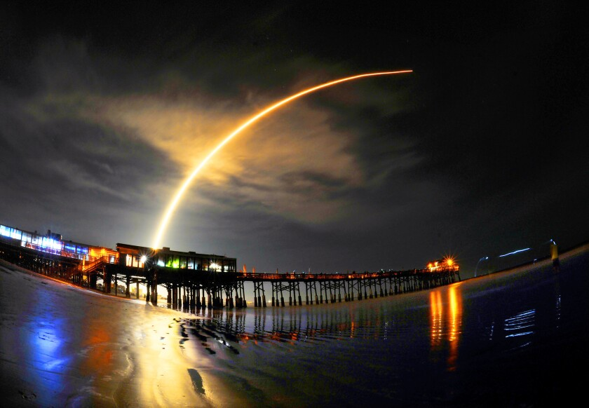 A SpaceX Falcon 9 rocket lights up the night sky on liftoff from Cape Canaveral, Fla., in August.