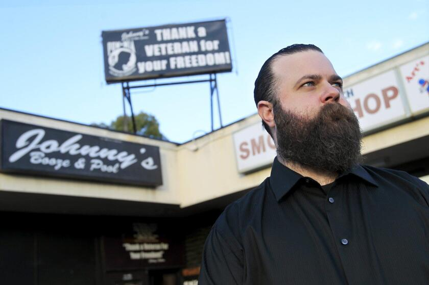 Johnny Nosich in front of Johnny's Saloon in 2013.