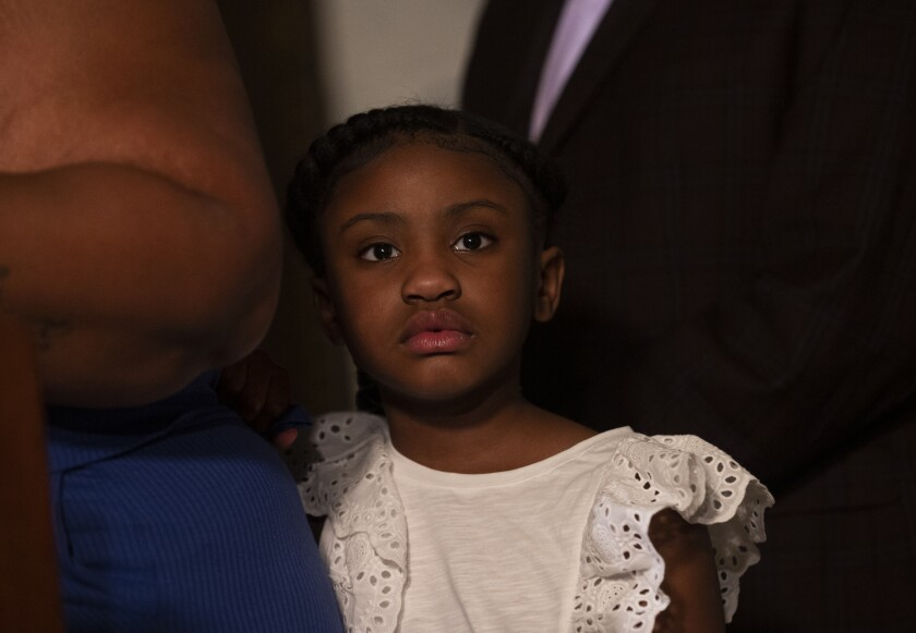 George Floyd's daughter Gianna Floyd, attends a press conference with her mother Roxie Washington.