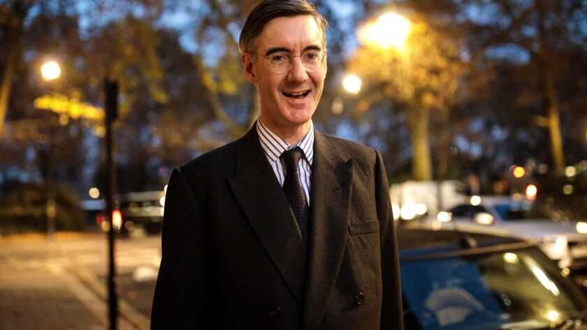 Conservative lawmaker Jacob Rees-Mogg walks in Westminster after submitting a letter calling for a vote of no-confidence in Prime Minister Theresa May.