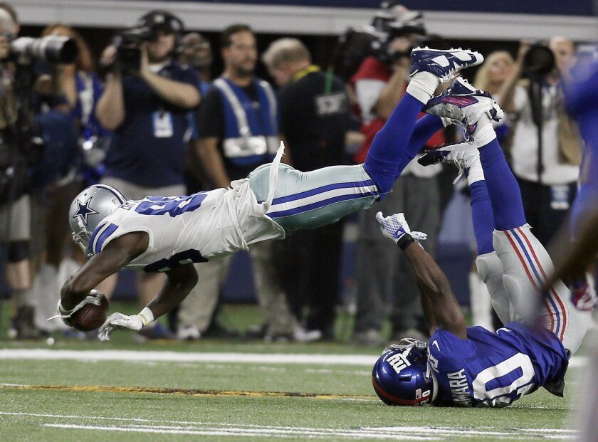 a13a25a58 The Associated Press. Dallas Cowboys wide receiver Dez Bryant (88) topples  over New York Giants cornerback Prince