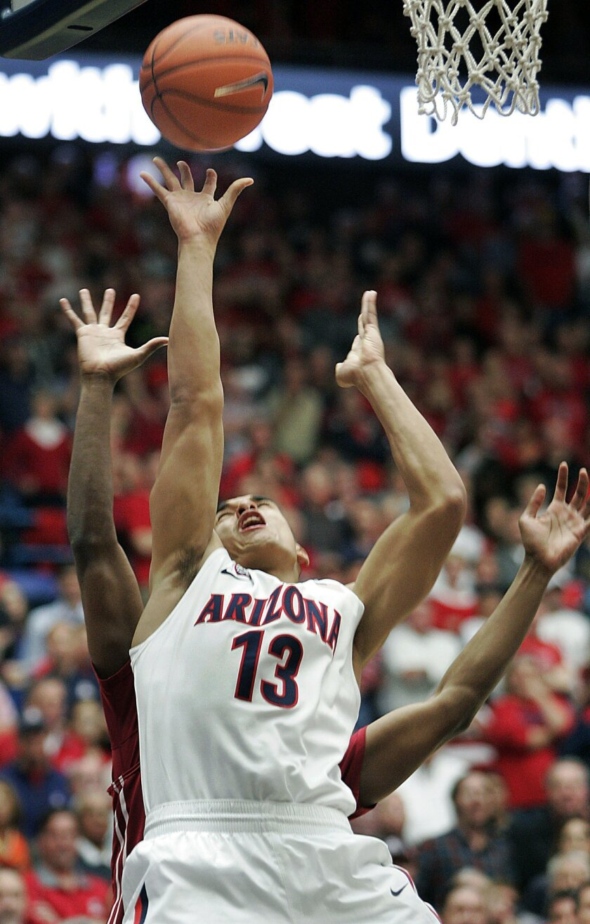 Arizona's Nick Johnson (13) shoots for two points despite the attempted defense by Washington States' Que Johnson, back, in the first half of an NCAA college basketball game on Thursday, Jan. 2, 2014, in Tucson, Ariz. (AP Photo/John MIller)