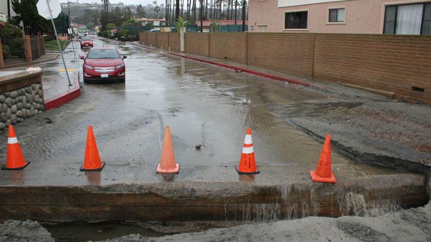 Urban runoff flooding Avenida de la Playa and forming a waterfall before it discharges into the ocean during a rain event Dec. 16, 2016.