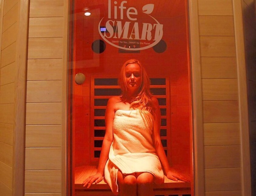A guest relaxes in the infrared color therapy sauna at the CloudMover Day Spa in Huntington Beach.