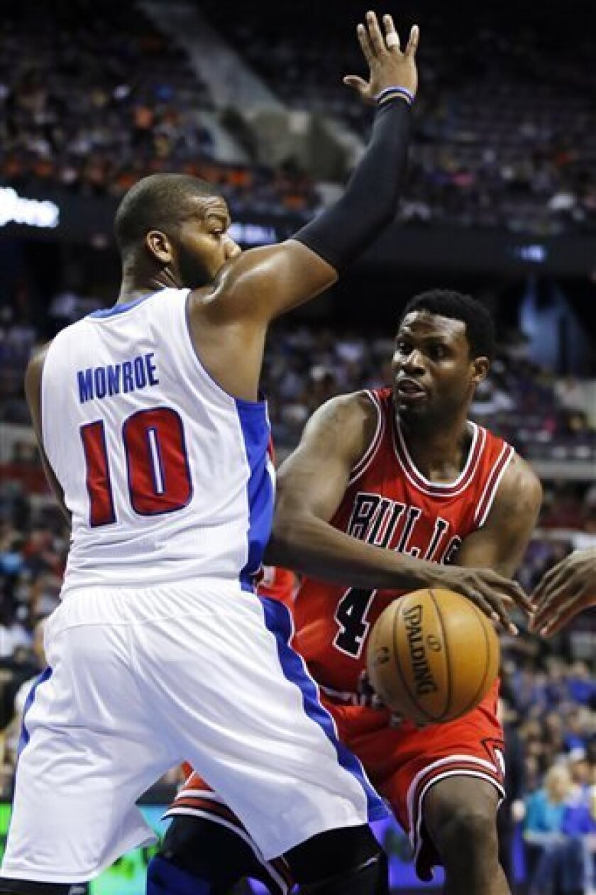 Chicago Bulls center Nazr Mohammed, right, looks to pass the ball around Detroit Pistons center Greg Monroe (10) in the first half of an NBA basketball game, Sunday, April 7, 2013, in Auburn Hills, Mich. (AP Photo/Duane Burleson)