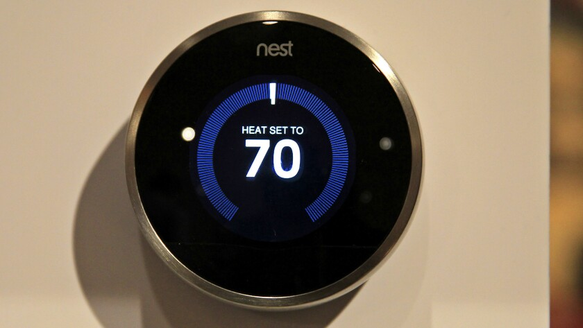 The Nest Learning Thermostat, which programs itself and can be controlled with a phone, is displayed at the Digital Experience portion of the 2015 CES at the Mirage Hotel in Las Vegas on Monday.