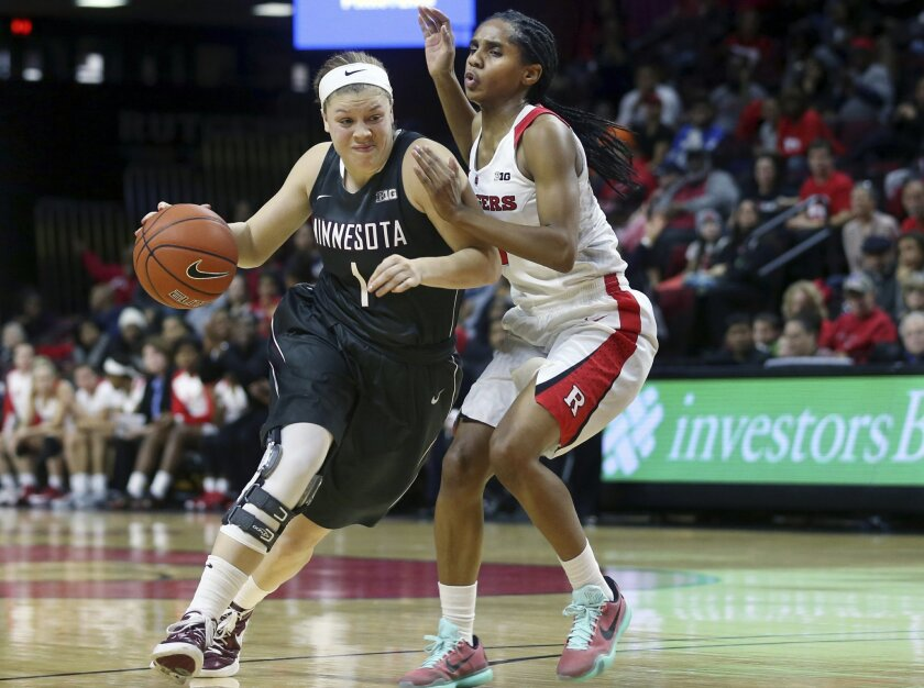 FIL - In this Dec. 31,2015, file photo, Minnesota guard Rachel Banham (1) dribbles the ball past Rutgers guard Tyler Scaife (3) during the second half of an NCAA college basketball game in Piscataway, N.J.  Banham was two days removed from her record-setting 60-point performance for Minnesota when
