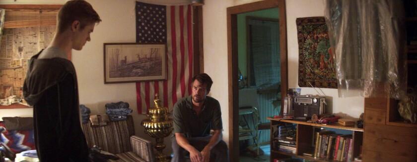 """Lucas Till, left, and Josh Duhamel in the movie """"Bravetown."""""""
