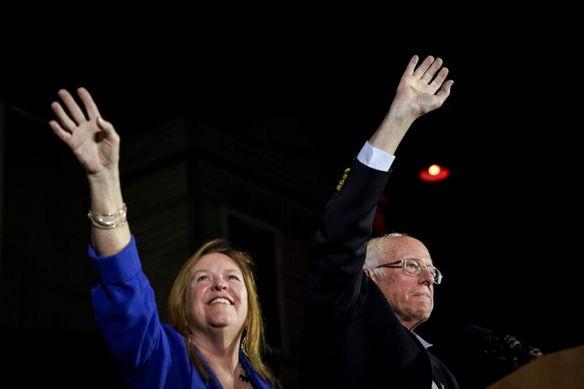 Democratic presidential candidate Sen. Bernie Sanders and wife Jane take the stage after Sanders won the Nevada caucuses.